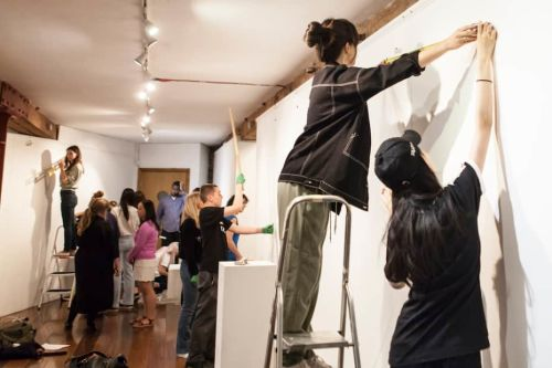 Students installing work