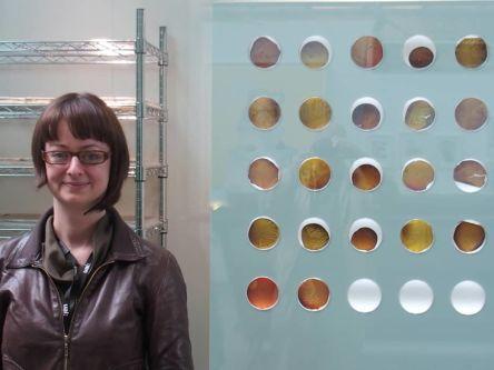 Sarah Craske stood next to her work