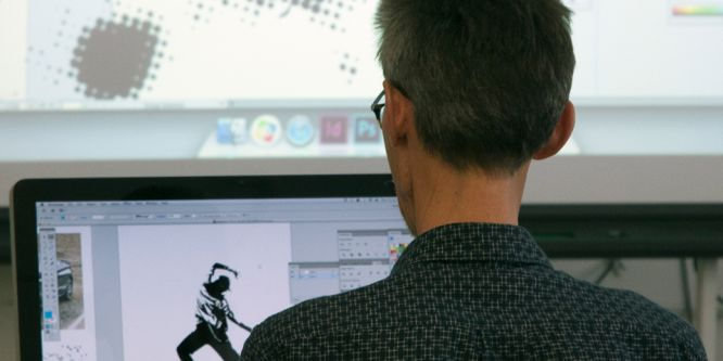 Man using Photoshop on an iMac
