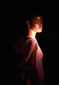 Model in red glow