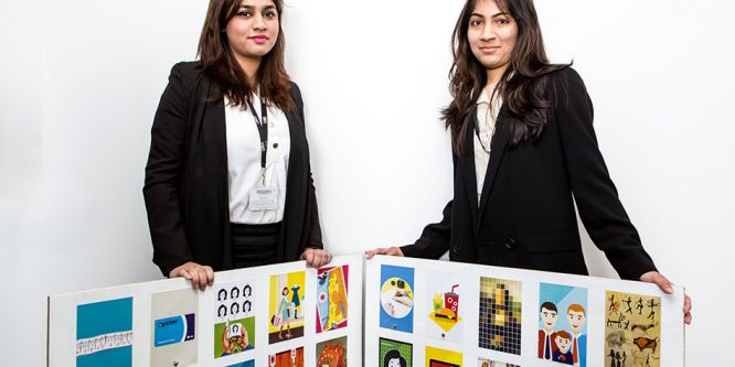 Two ladies pose with examples of ladybird book covers
