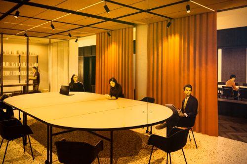 People sat around corporate looking boardroom.