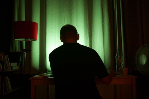 Man at desk with green light