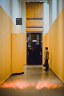 Corridor with woman stood at the end