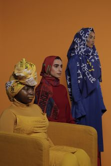 3 female models wearing hijabs in red, yellow and blue