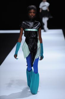Female model model wearing black dress with electric blue tights designed by Chendi Xu