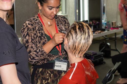 Female model with short blonde hair having her makeup done