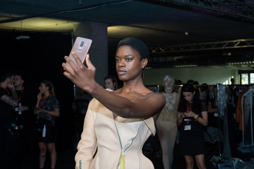 Model taking a selfie backstage