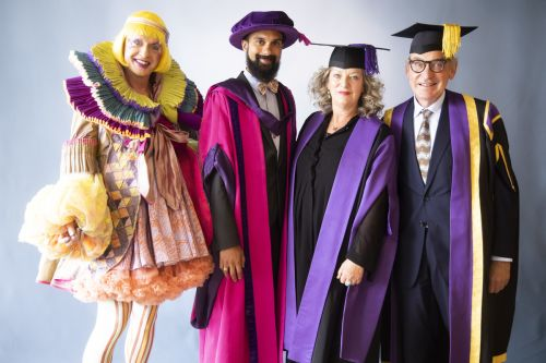 Grayson Perry posing with the Chancellors