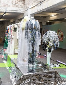 A catwalk with mannequins wearing garments design by UAL Awarding Body students