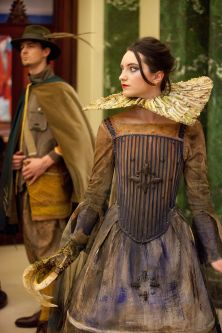 Fantasy female costume with a claw for one hand.
