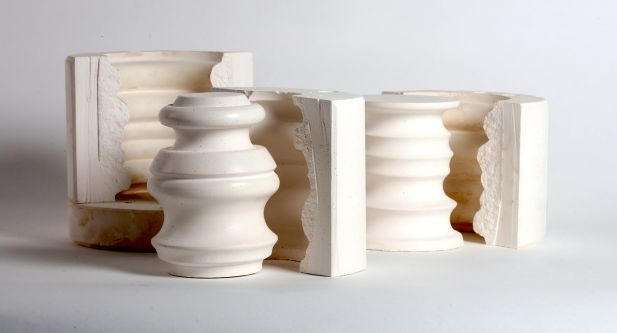 Curvaceous cream coloured ceramic sculptures made from moulds.