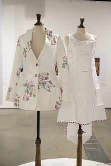 Two paper garments arranged on mannequins