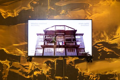 Screen showing outside of a building with words 'Excel' across it. Gold and brown wallpaper in an effect that resembles honey.
