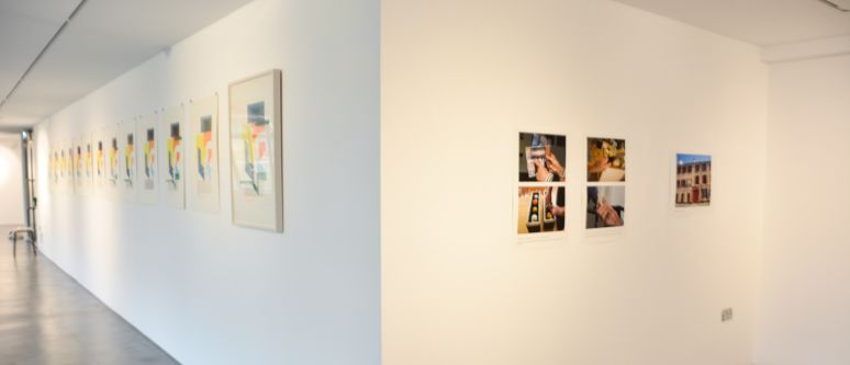 photos hung on a gallery wall