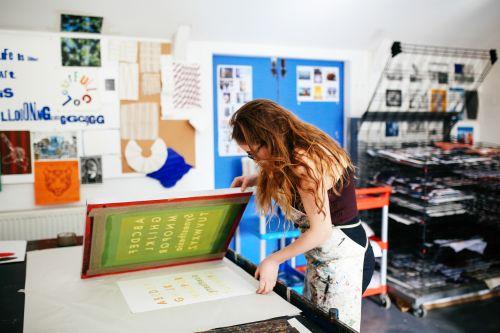 Student and tutor in the printmaking studio