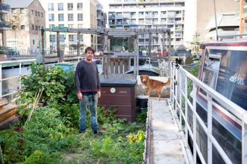man stood by his canal boat
