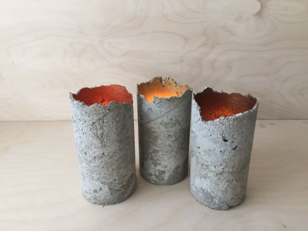 Three grey candle holders