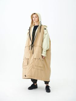 Female model in cream coloured oversized coat