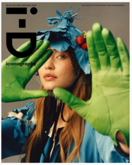 an ID magazine cover with a woman with hands out toward the camera wearing green gloves
