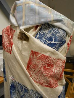 Fabric printed with blue and red patterns