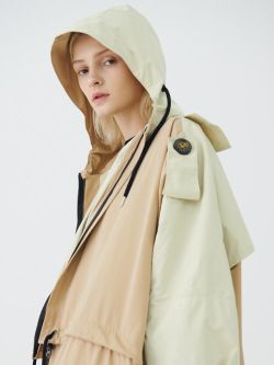 Blonde model in cream hooded jacket