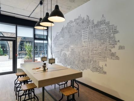 Photo of a large table in a communal area in the Highline Building