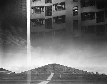 Black and white landscape with a mountain and skyscraper