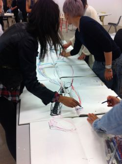 students drawing in a Fashion Illustration Class