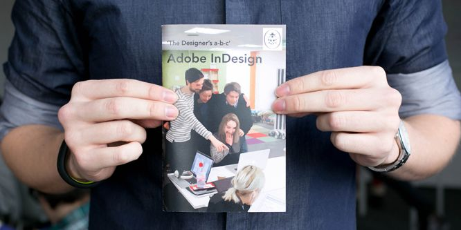 A man holds 'the Designers a-b-c' a guide to Adobe Indesign