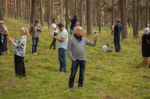 Participatory performance in forest by Paul Cegys. Photo by Andrej Vasilenko