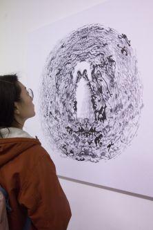Woman looking at drawing