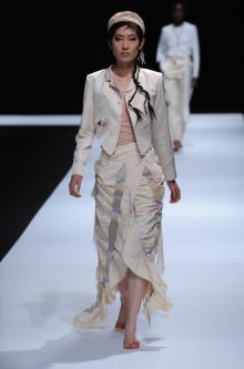 Female model wearing a multi-piece dress and jacket designed by So Jung Kim