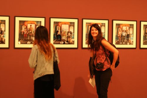 Two women looking at a set of photographs in the Turner gallery