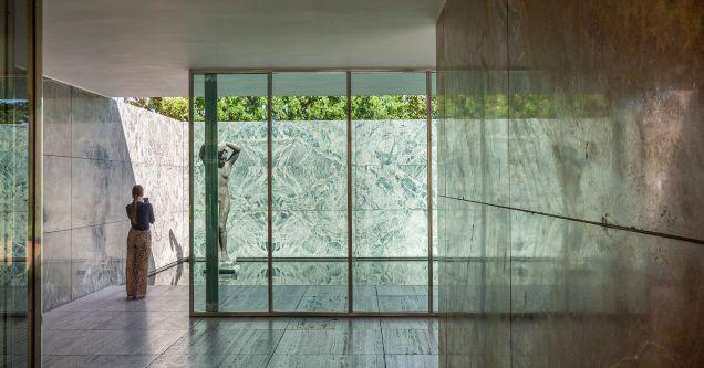 figure stood behind a glass window