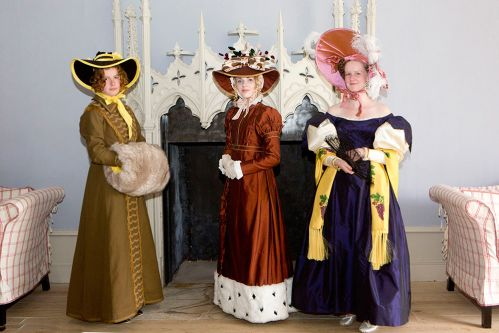 3 girls dressed in historical costumes.