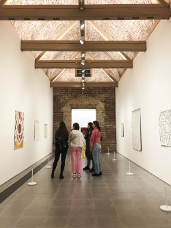 Students viewing exhibition from afar