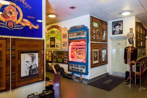 Corridor of The Cinema Museum, filled with vintage cinema objects, posters and costumes.