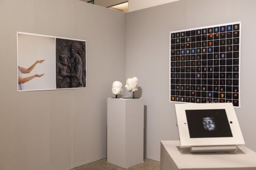 Exhibition space with mounted and screen work.