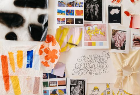 Studio wall with fabrics and prints