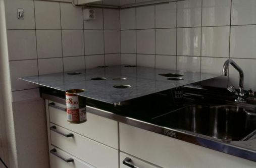 tin of soup hanging off worktop in kitchen