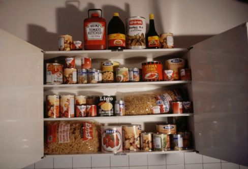 kitchen cupbard with retro tins and packets