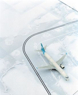 Photograph of an aeroplane in the snow