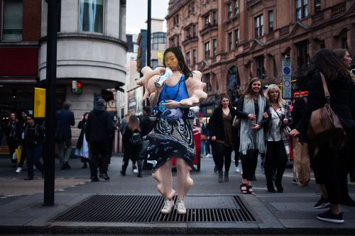 model on highstreet wearing a bodysuit garment with disfigured limbs