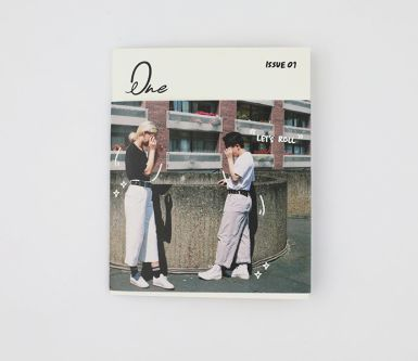 Fashion branding project by Thalia Lam. The front cover of a magazine, showing two figures standing facing each other by a wall, wearing white clothes.