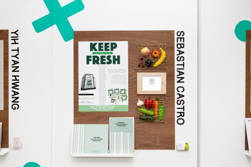 Exhibition wall display by an LCC student, showing a poster with the slogan 'Keep Fresh', alongside fresh fruits and vegetables.