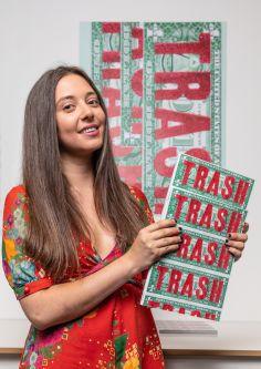 Portrait of woman holding Trash magazine
