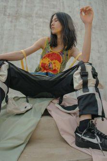 Model wearing tracksuit bottoms