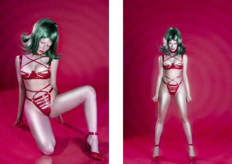 Female model standing on a pink background wearing a green wig and red lingerie