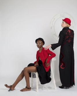 Female model sitting on chair, female model standing up wearing suits